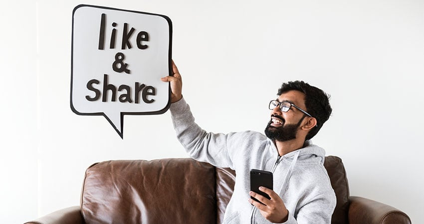 happy social media man on loveseat feature - How Social Media and Influencers Are Changing Ecommerce